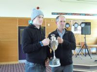Alan Blair presents Martyn Irvine with the Red Had Trophy